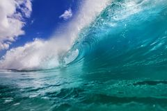 Ocean colorful bright wave with green blue water and splashed li Stock Photo