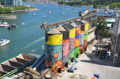 Ocean Concrete. VANCOUVER BC CANADA JUNE 10 2015: Ocean Concrete is Granville Island last tie to to its industrial past, and now 6 concrete silos are being stock images