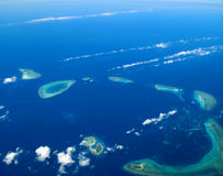Ocean and coralline island Stock Images