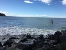 Ocean. Crashing wave, rocks, coastline Royalty Free Stock Photos