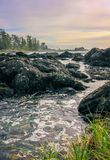 Ocean Current Flowing Through Rocks. UCLUELET, BC - JULY 5, 2015 - The ocean current flowing through some rocks on July 5, 2015, in Ucluelet Stock Photography