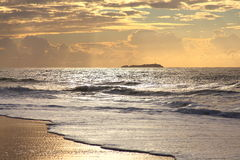Golden morning at beach by dawn stock photography