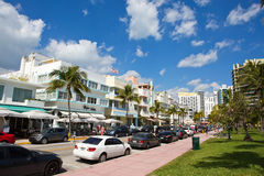 Ocean Drive Miami Beach. MIAMI BEACH, FLORIDA - FEBRUARY 15, 2017: Tourists stroll along famous Ocean Drive which runs parallel to Southbeach in Miami Beach Royalty Free Stock Image