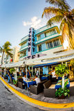 Ocean Drive in Miami with Restaurants in front of the famous Art Deco Style Colony Hotel. MIAMI, USA - July 31:  The Colony hotel located at 736 Ocean Drive and Royalty Free Stock Images