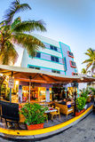 Ocean Drive in Miami with Restaurants in front of the famous Art Deco Style Colony Hotel. MIAMI, USA - July 31:  famous Starlite hotel located at 750 Ocean Drive Royalty Free Stock Photo