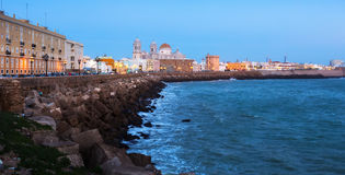Ocean   embankment and Cathedral in twilight. Cadiz Stock Image