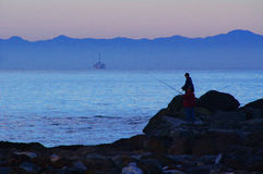 Ocean Fishermen. On California coast with Santa Cruz Island in the background Stock Image