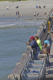 Ocean Fishing Off the Pier Royalty Free Stock Images