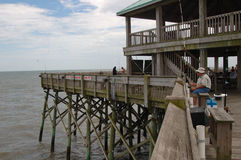 Ocean Fishing Pier. At Folly Beach near Charleston, SC Stock Photo