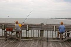 Ocean Fishing Pier Twins. Ocean fishing pier at Folly Beach near Charleston, SC royalty free stock photos