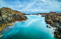 The ocean flowing through the canal rocks Stock Photo