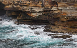 Ocean flows into sea caves Stock Images