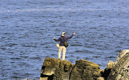 Ocean fly fishing. Man fly fishing in the ocean Stock Images