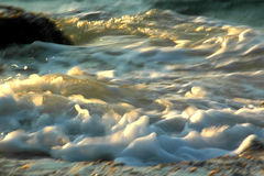 Ocean Foam. As the ocean reaches the shore, the water foams Royalty Free Stock Images