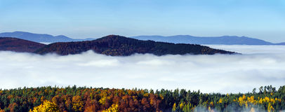 Ocean of fog movement under the camera. Great overcast over Alsace. Panoramic view from top of the mountain. Stock Images