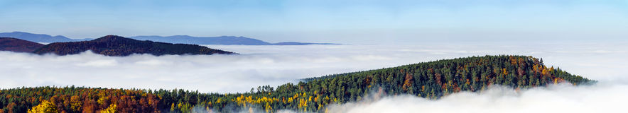 Ocean of fog movement under the camera. Great overcast over Alsace. Panoramic view from top of the mountain. Royalty Free Stock Photo