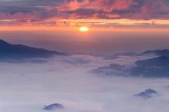 Ocean of fog and sunrise Stock Photos