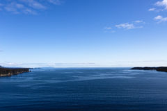 Ocean Fringed by Land. The calm North Pacific Ocean under a beautiful blue sky Royalty Free Stock Image