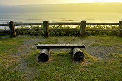 Ocean Front Bench. Small Wood Bench at Scenery Viewpoint. Washington State Olympic Peninsula. Recreation Photo Collection. Pacific Ocean Royalty Free Stock Photos