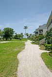Ocean Front Condos. A view down a shell path of ocean front condos and a grassy ocean view Stock Image