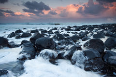Ocean full of foam at twilight Stock Images