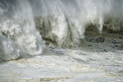Ocean Fury and Force. A large wave breaking on the shoreline bursting with force and fury Stock Photo