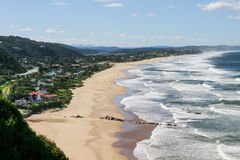Ocean in Garden Route. Homes situated on the beach in Mossel Bay Royalty Free Stock Image
