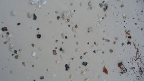 Ocean glass. Sea glass, shells, rocks spread across the beach Royalty Free Stock Photography