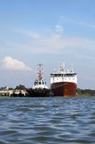 Ocean going ship with tug Cochin India Stock Photo