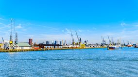 Ocean going vessels in the busy harbor of Rotterdam royalty free stock images