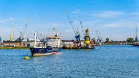 Ocean going vessels in the busy harbor of Rotterdam stock photography