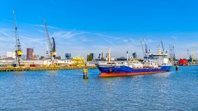 Ocean going vessels in the busy harbor of Rotterdam stock image