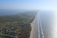Aerial image of the Texas Gulf Coast, Galveston Island, United States of America. Haze due to warm weather conditions. Ocean, Gulf of Mexico, beach, real estate royalty free stock photos
