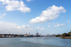 Ocean and Harbor and Blue Cloudy City Skyline Stock Photography