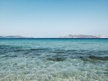 Ocean horizon. Ocean with blue and green water and land in the distance Royalty Free Stock Image
