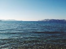 Ocean horizon. With land in the distance Royalty Free Stock Photo