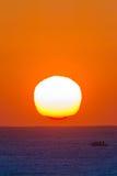 Ocean Horizon Sunrise Landscape. Ocean horizon sunrise colors with fishing boat on the landscape Stock Image