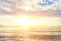 Ocean horizont with cloudy sky and burning sun Royalty Free Stock Images