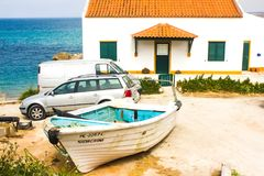 The ocean, the house and its residents vehicles. A house over the Atlantic Ocean and its residents vehicles in Baleal Island - really a isthmus - in Peniche Royalty Free Stock Photos