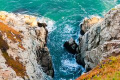 Ocean Inlet Between Rocky Outcrops Royalty Free Stock Photography
