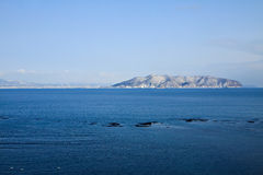 Ocean with island Stock Photography