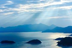 Ocean islands sunrise Landscape. Ocean landscape with sunshine, islands and mountains Stock Photo