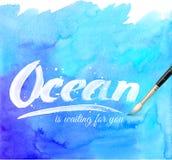 Ocean kaligrafii znak na błękitnej akwareli Obrazy Royalty Free