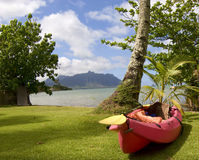 Ocean Kayak at Kaneohe Bay, Hawaii. A red kayak near the shore in Kaneohe Bay on the island of Oahu, Hawaii Royalty Free Stock Image