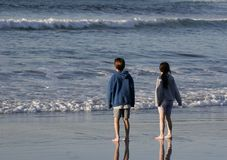 Ocean Kids. A boy and girl playing at the surf's edge Royalty Free Stock Images