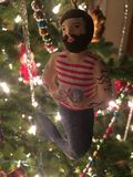 Merman Christmas ornament lights. Ocean king merman tattoos muscles beard brown hair sea shells mermaid stock photography