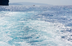 Ocean landscape with boat seafoam Royalty Free Stock Images