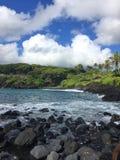 Black sand beach Ocean scene in maui hawaii Royalty Free Stock Photography