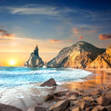 Ocean Landscape at Sundown time, beautiful rocks and stones beac Royalty Free Stock Photography