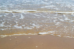 Ocean lapping onto a quiet beach. Royalty Free Stock Photography